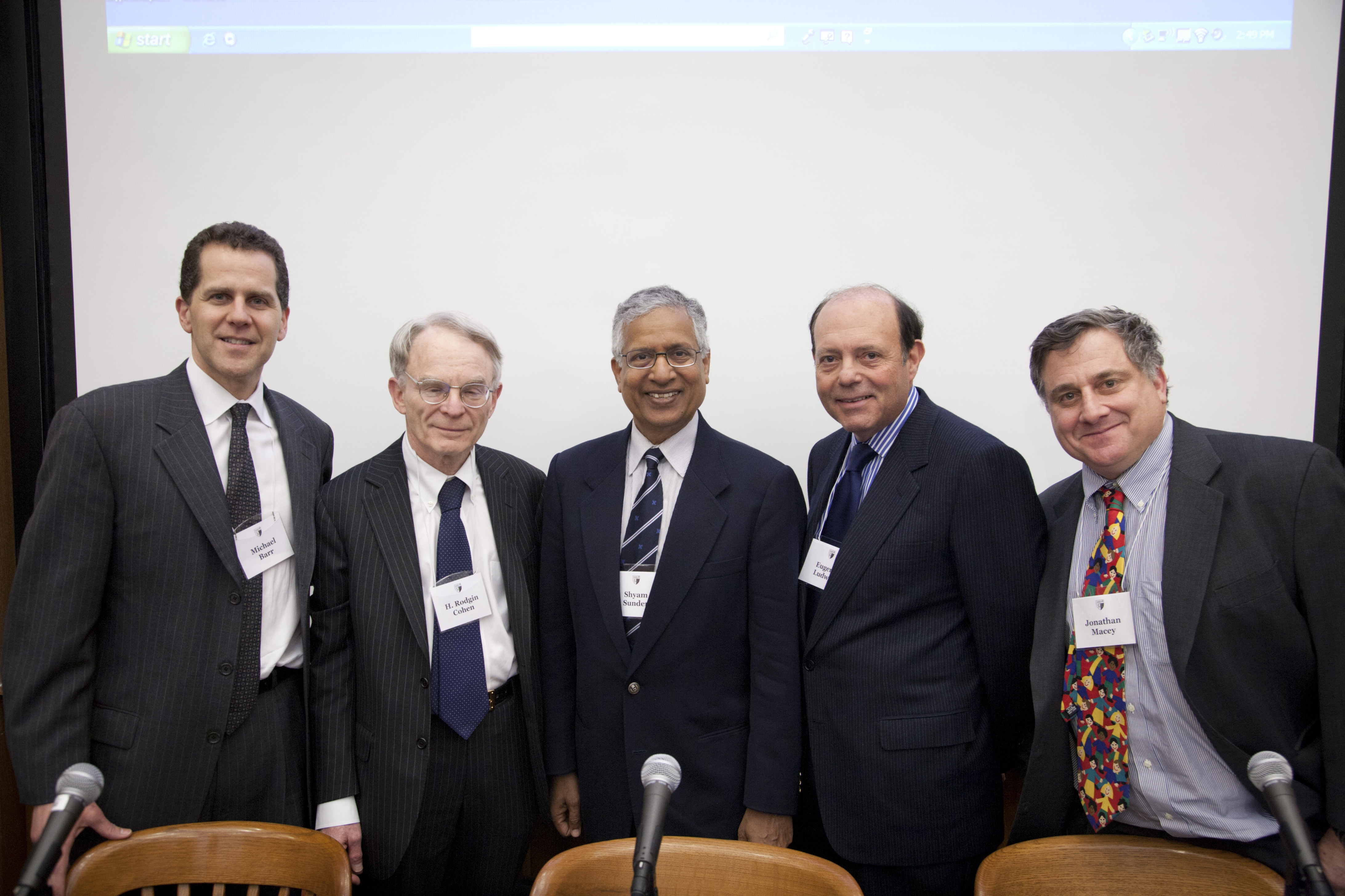 Michigan Law Prof. Michael Barr '92, H. Rodgin Cohen, Yale SOM Prof. Shyam Sunder, Eugene Ludwig '73, and YLS Prof. Jonathan Macey '82