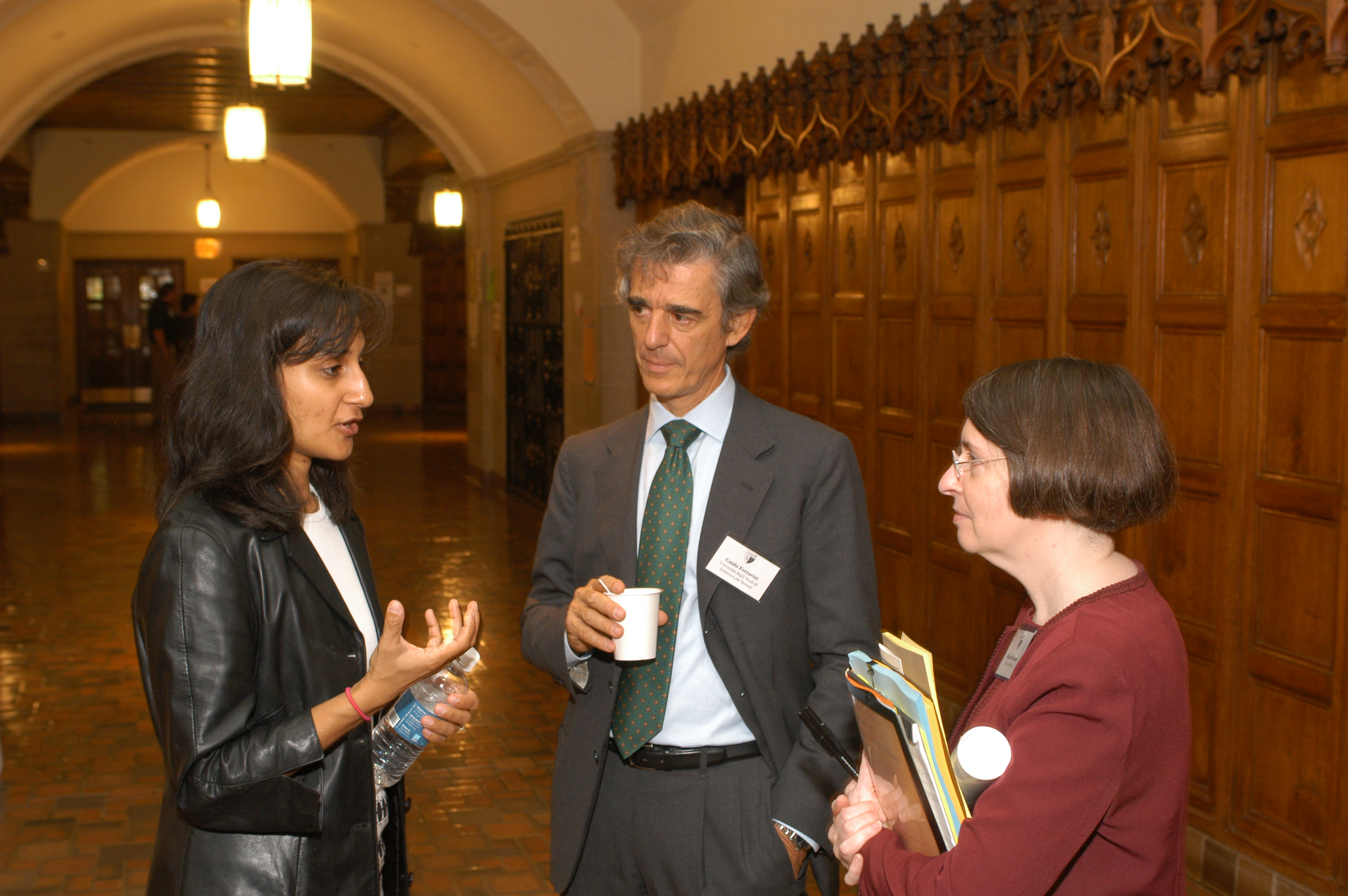 Queen's Law Prof. and YLS Visiting Prof. Anita Anand, U. of Genoa Business Law Prof. Guido Ferrarini LLM '78, and YLS Prof. and Center Director Roberta Romano '80
