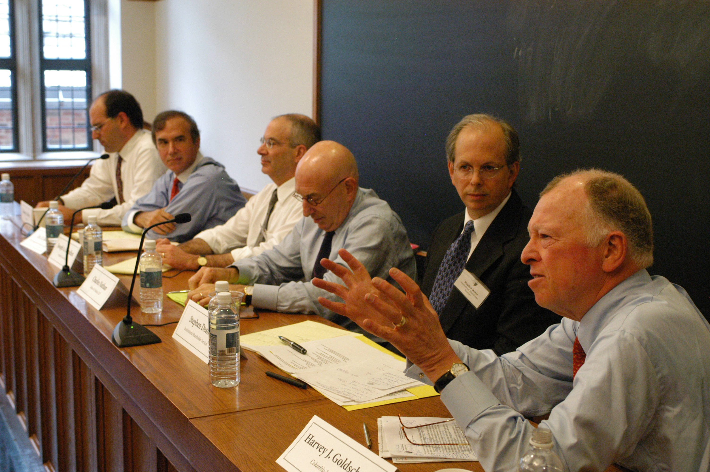 Damon Silvers, Eric Roiter, Stanford Law Prof. Joseph Grundfest, Charles Nathan '65, Stephen Deane, and Columbia Law Prof. Harvey Goldschmid