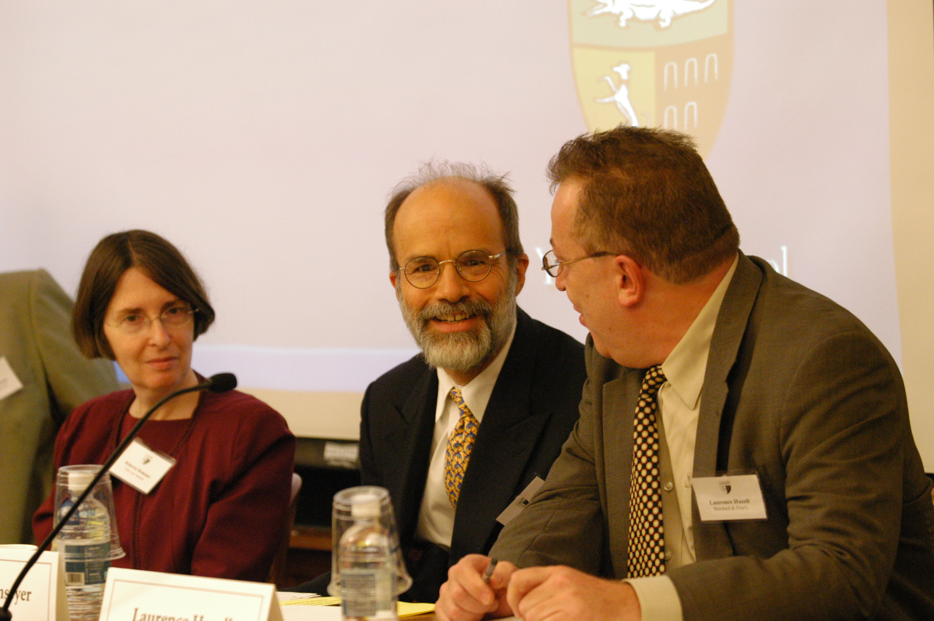 YLS Prof. and Center Dir. Roberta Romano '80, Harvard Law Prof. J. Mark Ramseyer, and Laurence Hazell