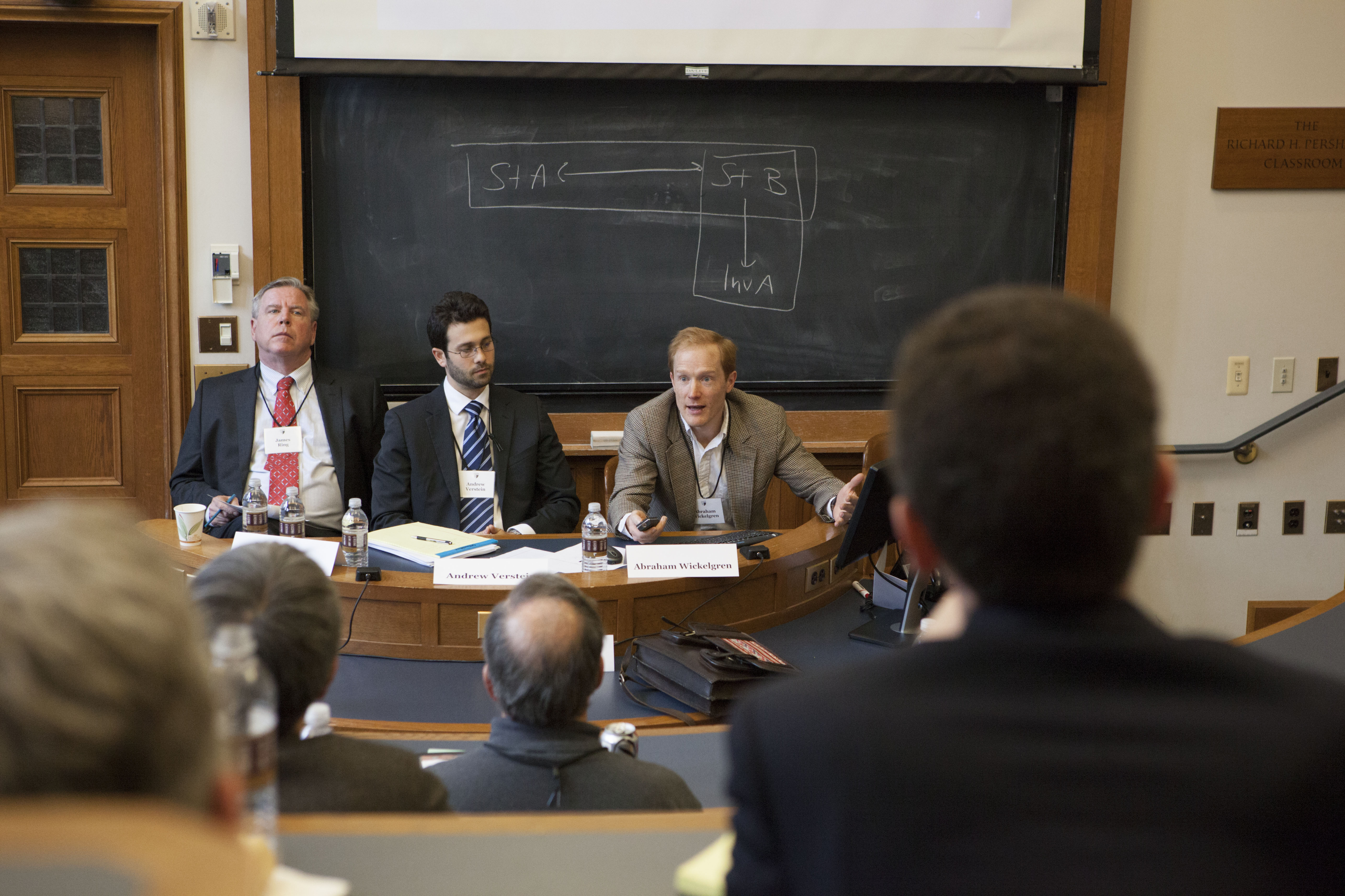 James F. Ring, Andrew Verstein '09, and Texas Law Prof. Abraham Wickelgren