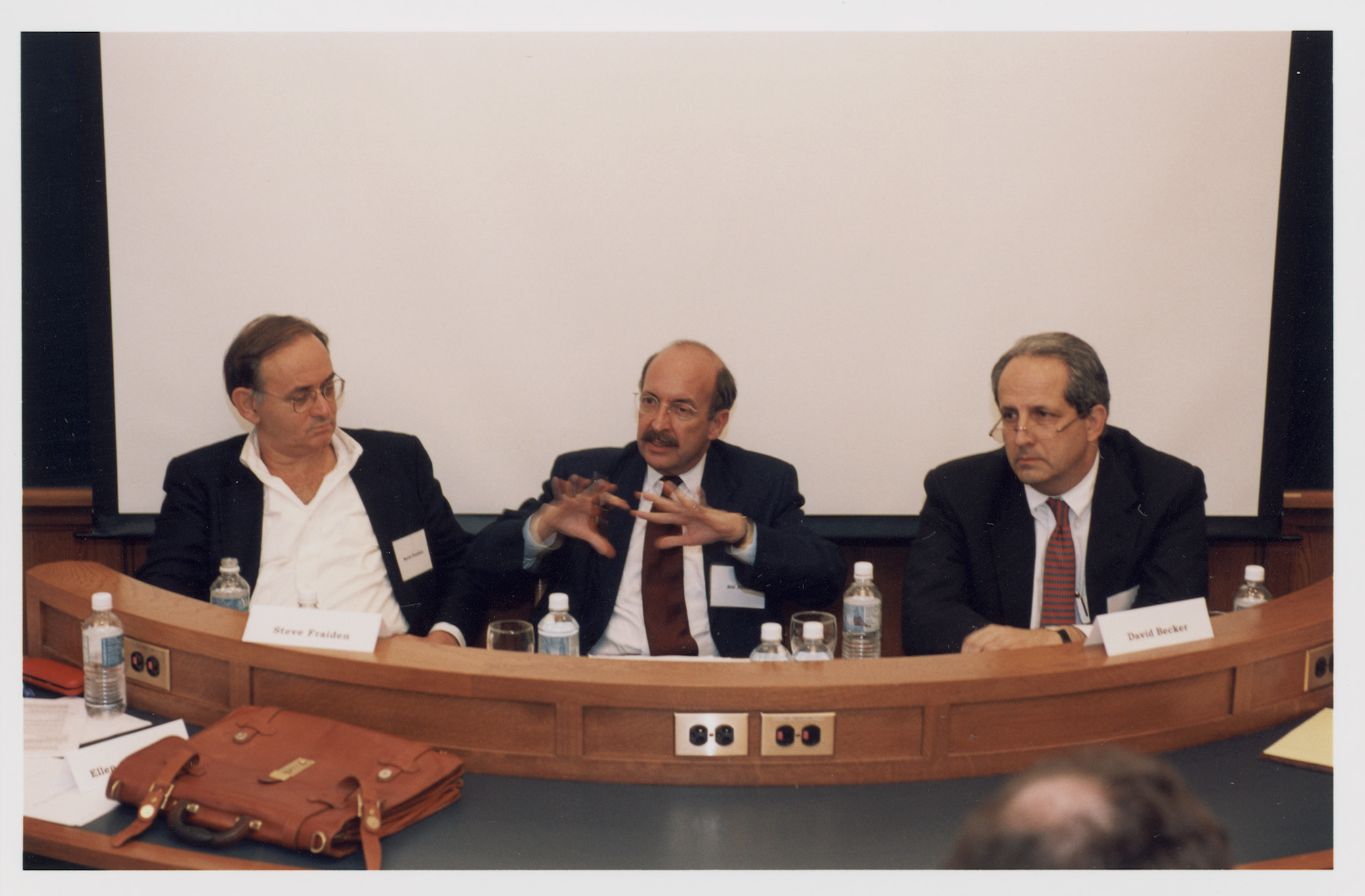 Stephen Fraidin '64, NYU Law Prof. William T. Allen, and David M. Becker