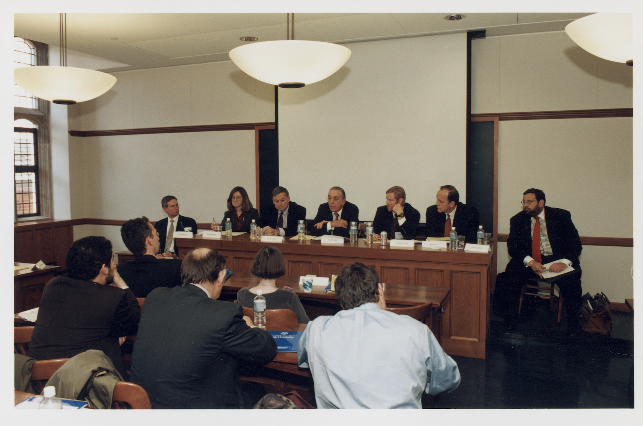 UVA Law Prof. Paul Mahoney '84, Belinda Blaine, T. Grant Callery, Robert Todd Lang '47, Wash. U. Olin School of Business Prof. S. Craig Pirrong, Edward Nicoll '97, and Harvey Pitt