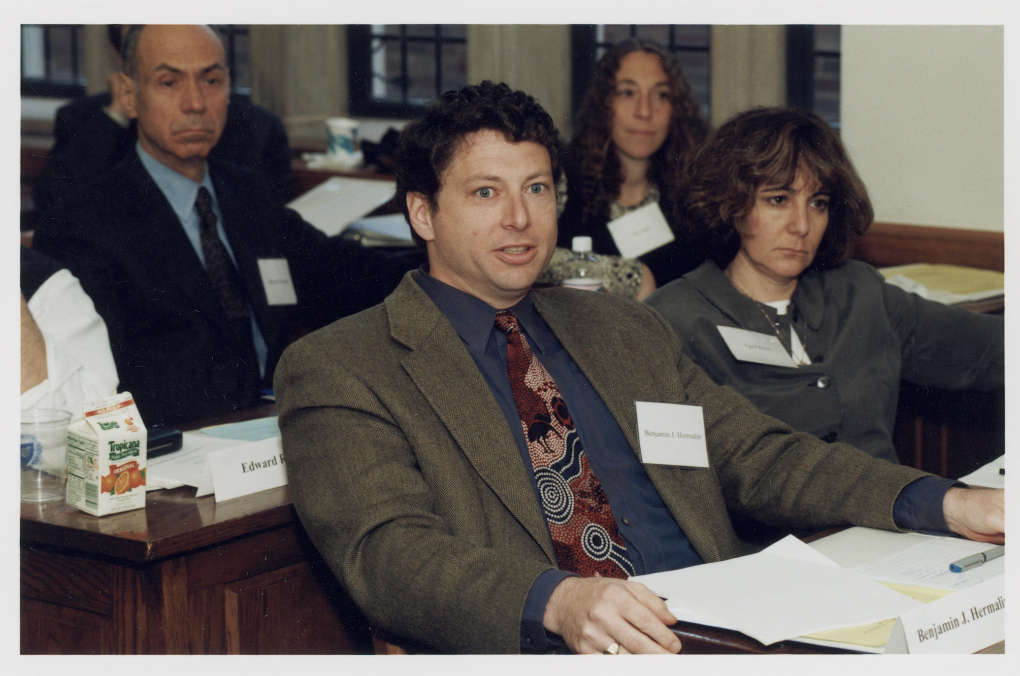 Berkeley Haas Prof. Benjamin E. Hermalin and NYU Stern Prof. April Klein (foreground); Penn Law Prof. Michael Wachter and Fordham Law Prof. Jill Fisch '85 (background)