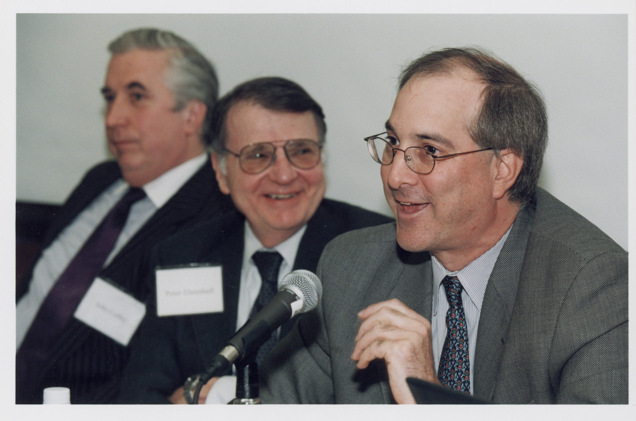Steven Kargman '86 (foreground) and Columbia Law Prof. John C. Coffee, Jr. '69 and Peter D. Ehrenhaft (background)