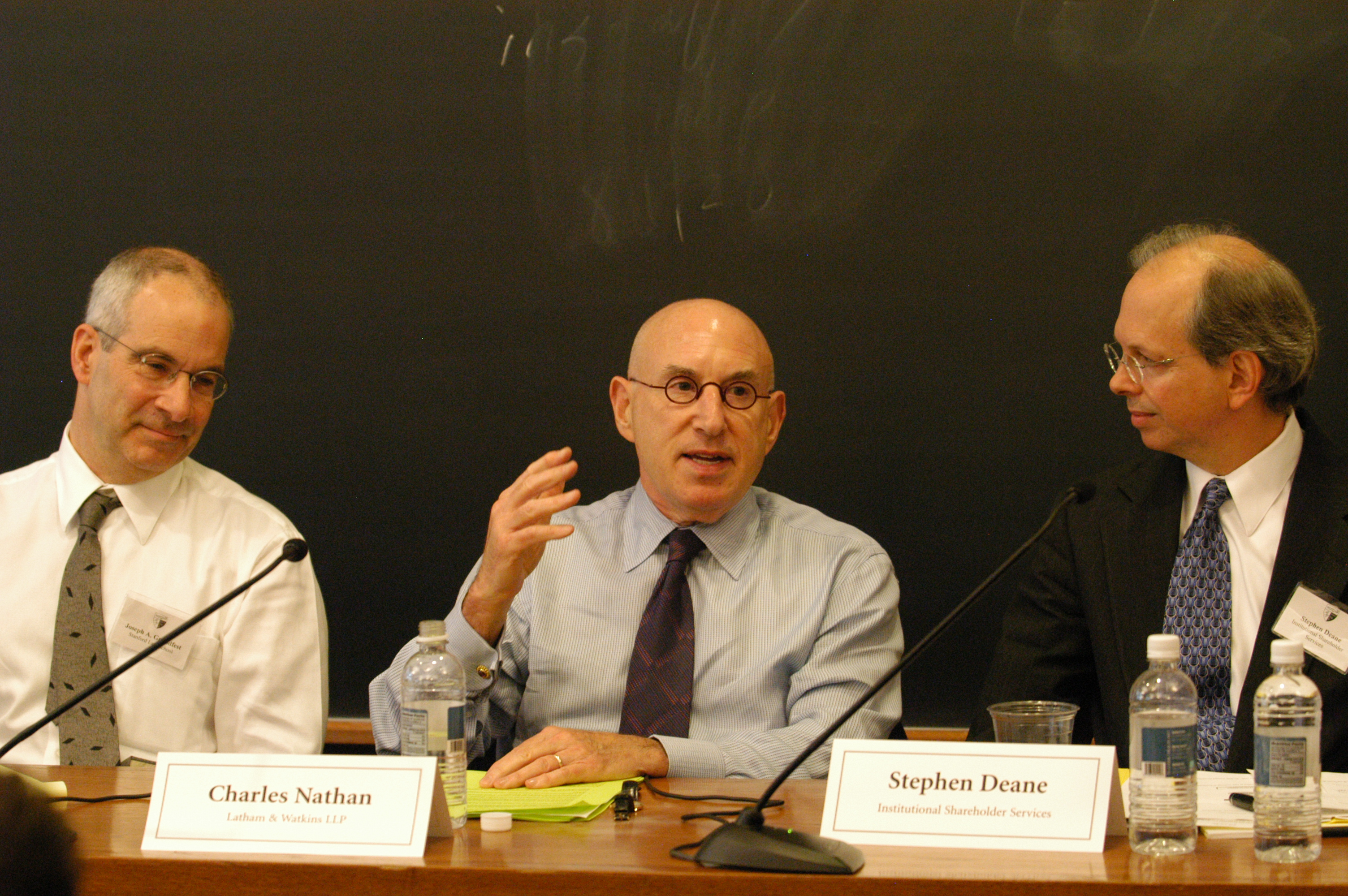 Stanford Law Prof. Joseph Grundfest, Charles Nathan '65, and Stephen Deane