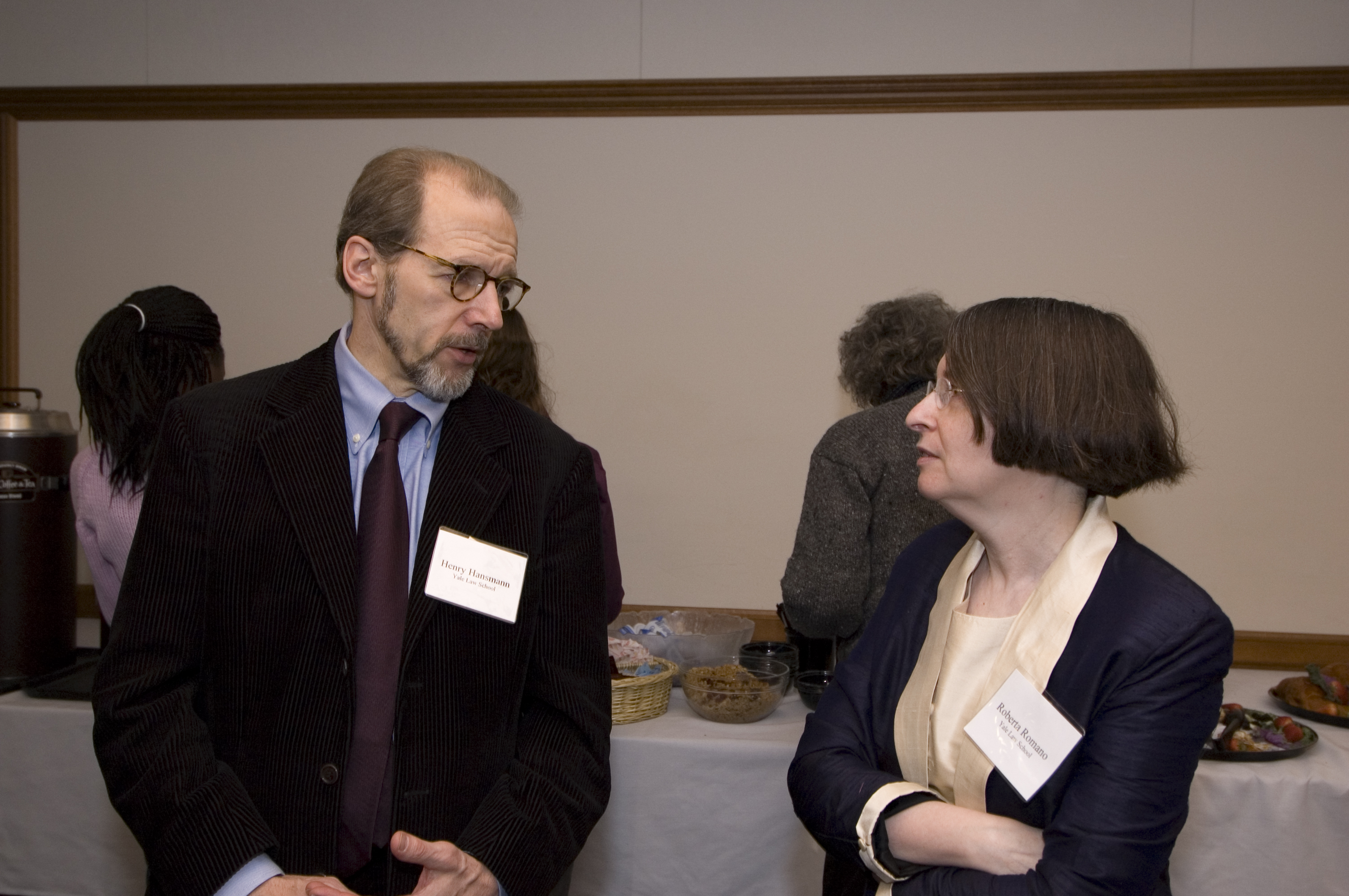 YLS Prof. Henry Hansmann '74 and YLS Prof. and Center Dir. Roberta Romano '80