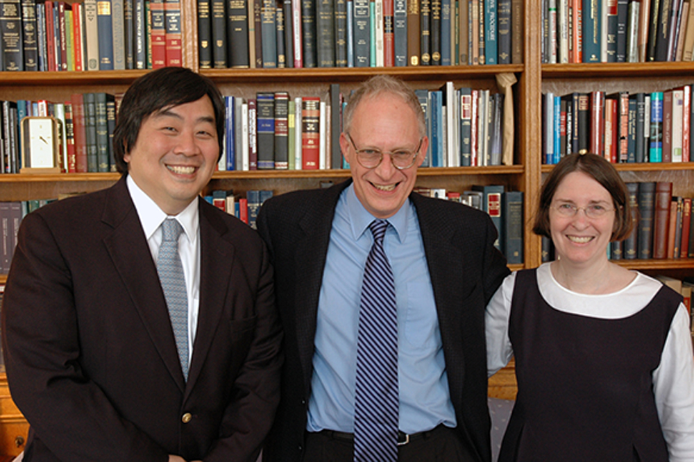YLS Dean Harold Koh, Harvard Econ. Prof. Oliver Hart, and YLS Prof. and Center Dir. Roberta Romero '80