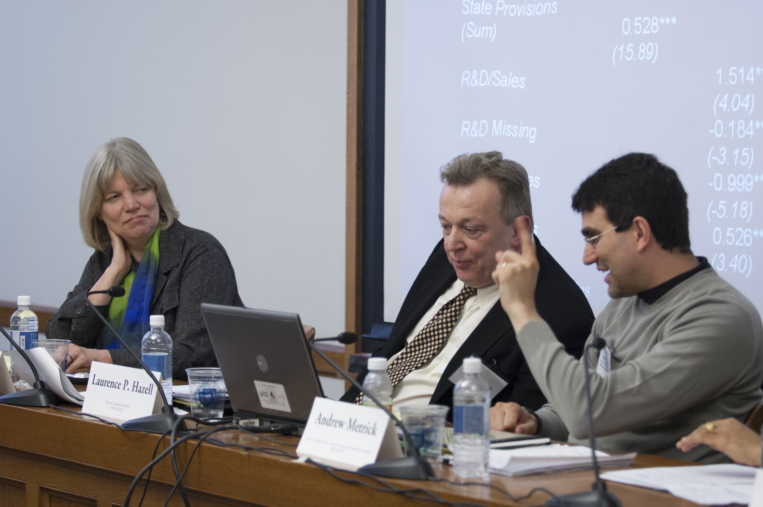 Texas McCombs Prof. Laura Starks, Laurence Hazell, and Yale SOM Prof. Andrew Metrick