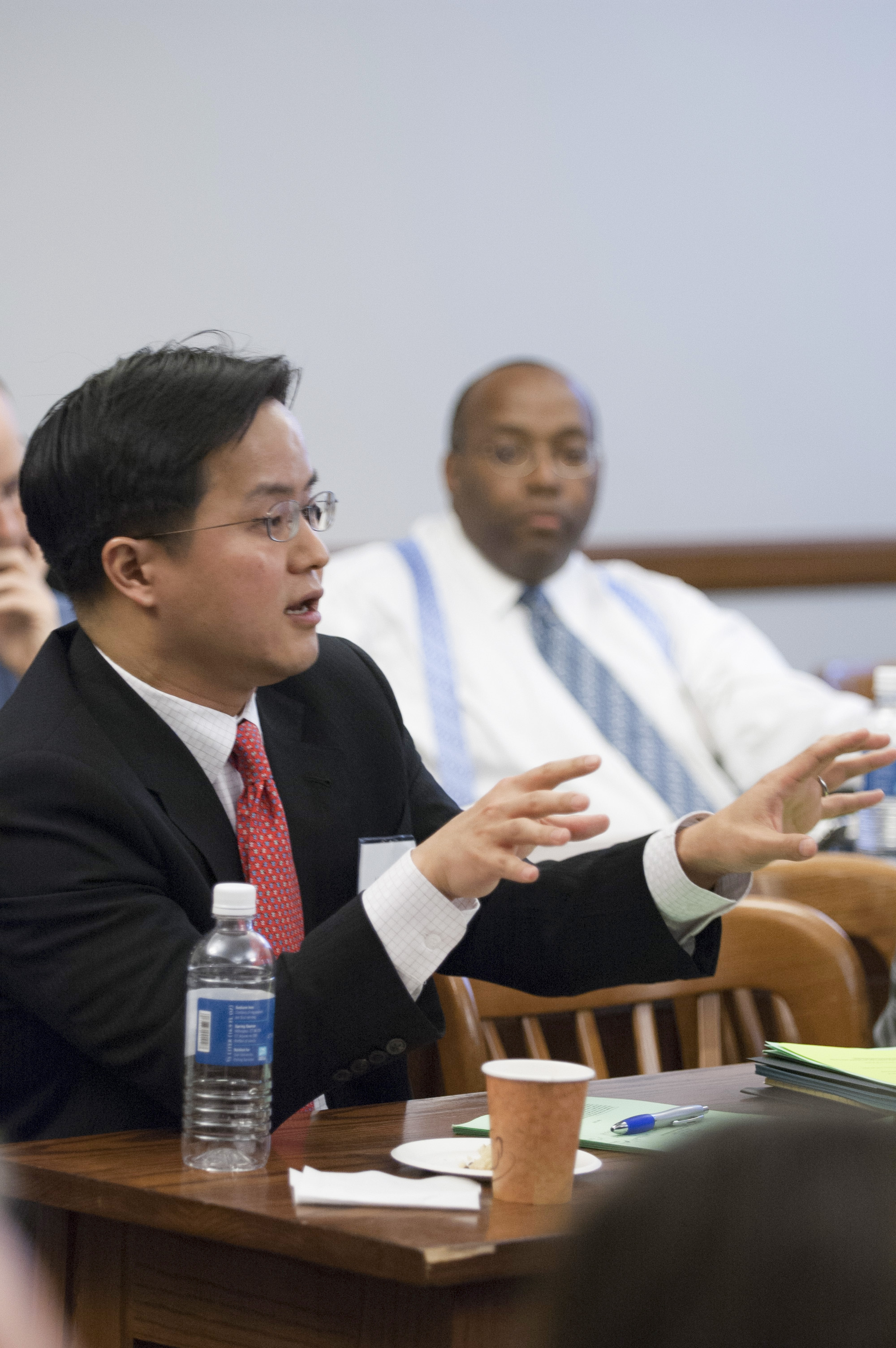 UVA Law Prof. Albert Choi '01 (foreground) and Francis Byrd (background)