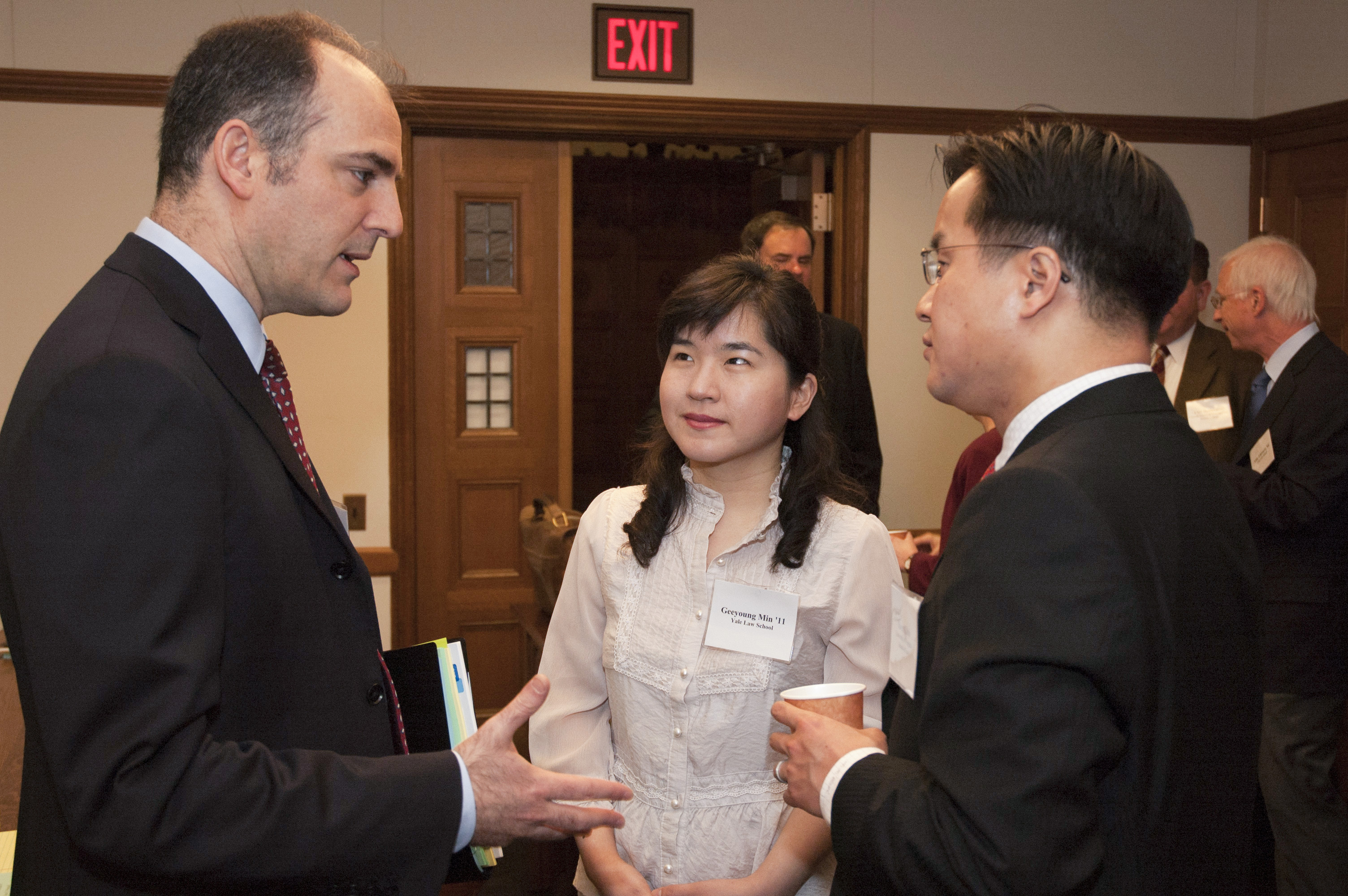 USC Law Prof. Ehud Kamar, Geeyoung Min LLM '05, and UVA Law Prof. Albert Choi '01