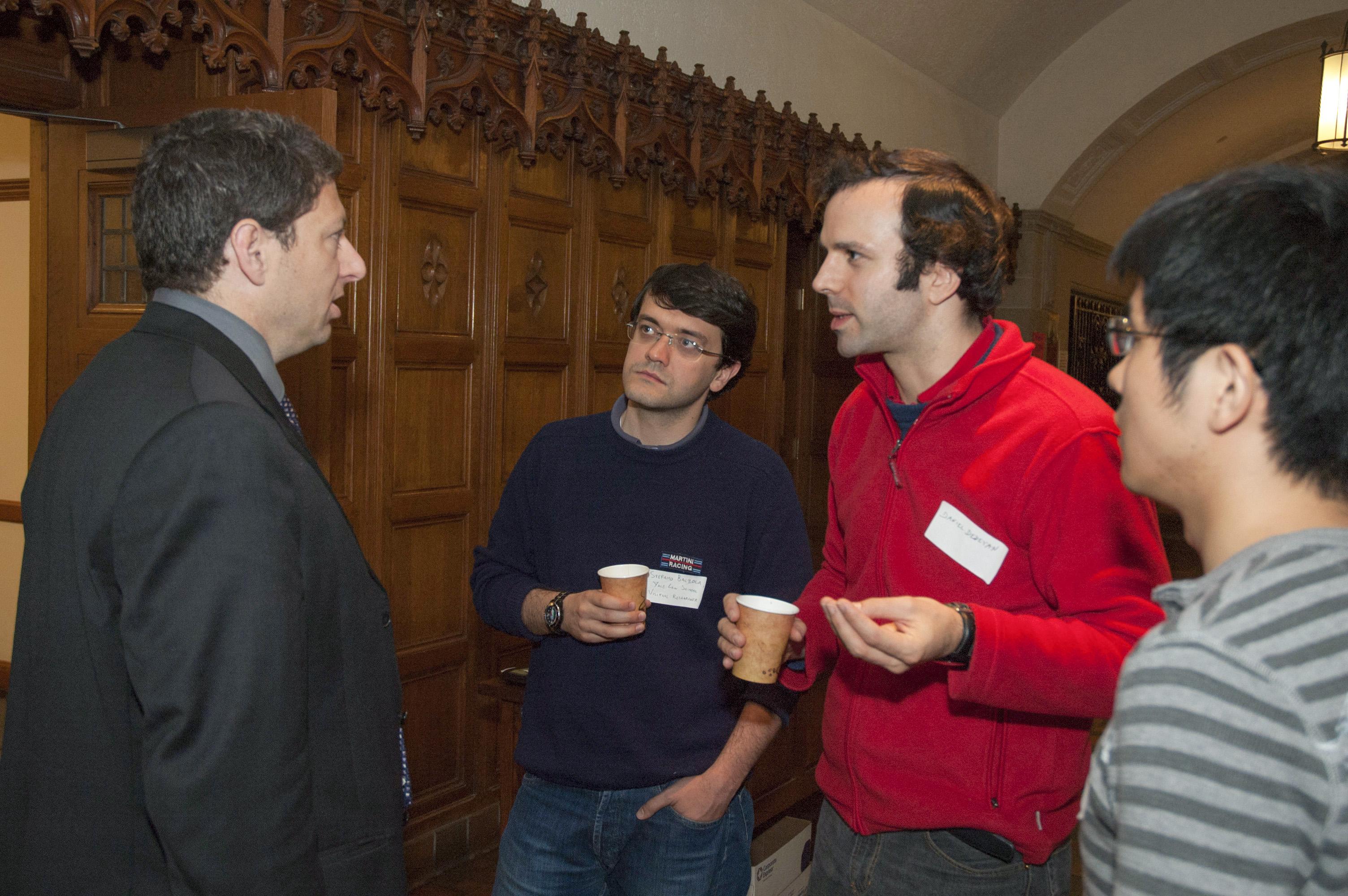 Berkeley Haas Prof. Benjamin Hermalin talks with YLS students during a break.
