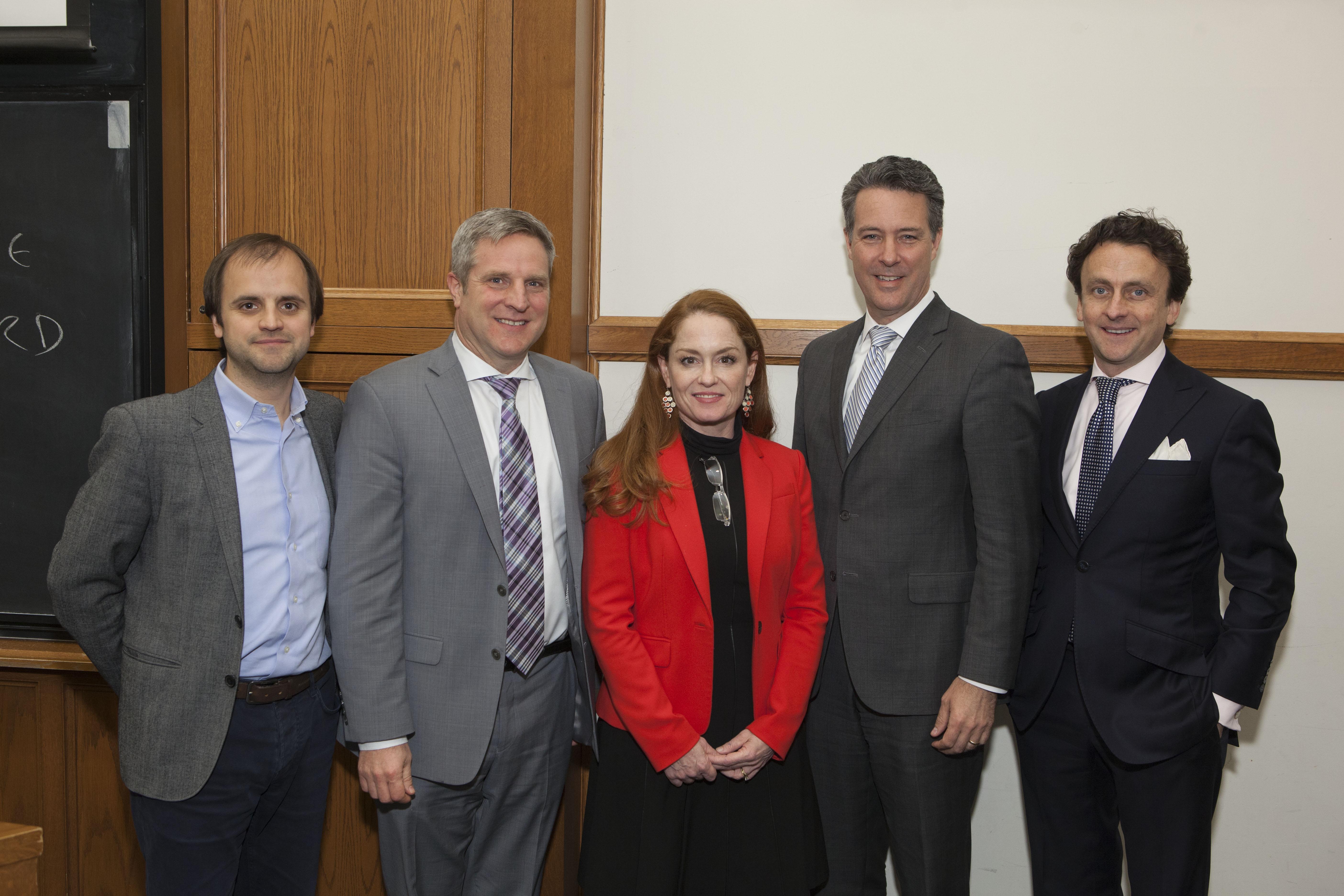 MIT Sloan Prof. Christian Catalini, U. of Toronto Rotman Prof. Alexander Dyck, Nina Kilbride, Scott O'Malia, and Charley Cooper