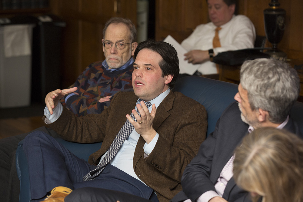 YLS Prof. David Schleicher '04 (center) asking a question, while YLS Profs. Al Klevorick (left) and Ian Ayres '86 (right) listen