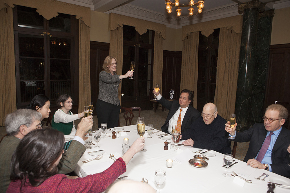 YLS Dean Heather Gerken (center) leading a toast to the Hon. Ralph K. Winter '60 (second from the right)