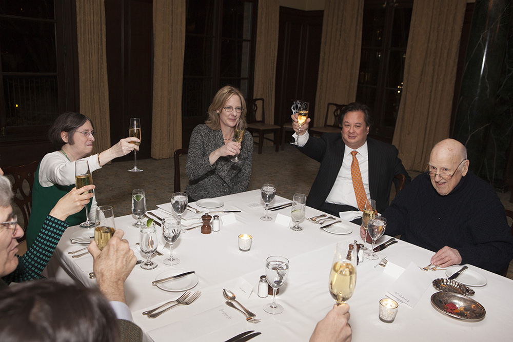 Another toast to the Hon. Ralph K. Winter '60 (right), with (starting from left) the Hon. José A. Cabranes '65, Center Exec. Dir. Nancy Liao '05, YLS Prof. and Center Dir. Roberta Romano '80, YLS Dean Heather Gerken, and George T. Conway '87 raising glasses
