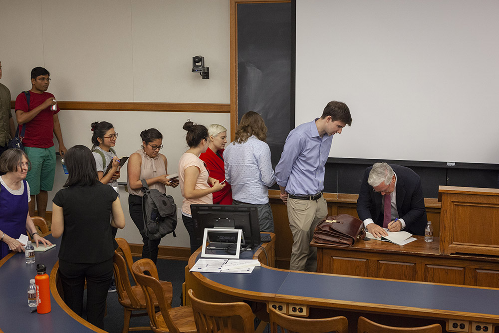 """Audience members lining up to have NYU Stern Econ. Prof. Lord Mervyn King autograph his book, """"The End of Alchemy"""""""