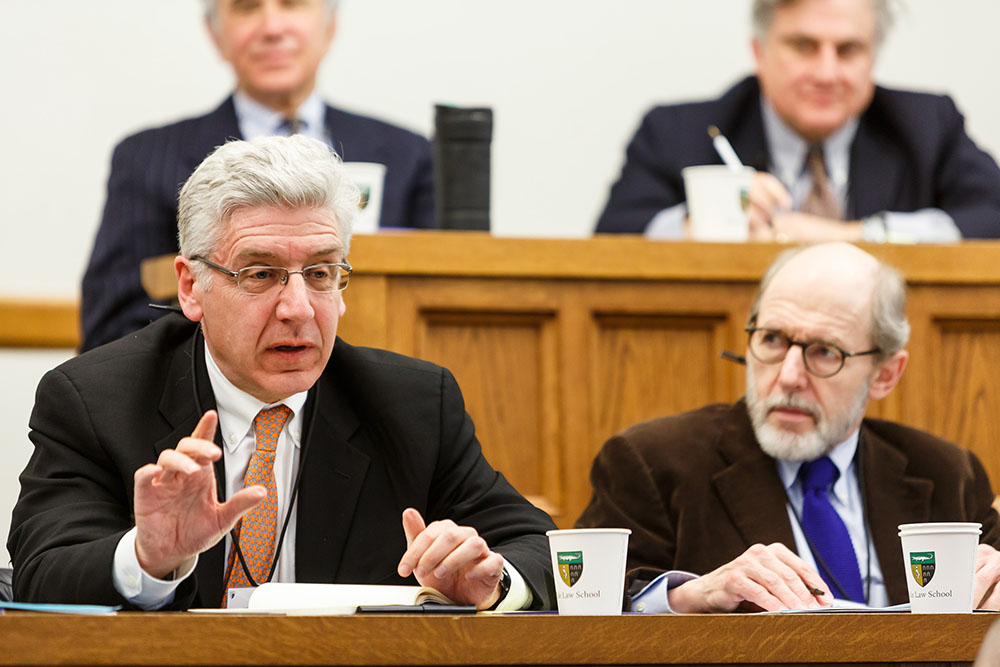 Foreground: Brooklyn Law Prof. Ted Janger and YLS Prof. Henry Hansmann '74; Background: Boston U. Law Lecturer Eric Roiter and YLS Prof. Jonathan Macey '82