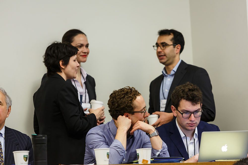 Foreground: Ram Sachs '19 and Mark Andriola '19; Background: Sadie Blanchard '10, U. of Toronto Faculty of Law Prof. Adriana Robertson '15, and Michigan Law Prof. Gabriel Rauterberg '09