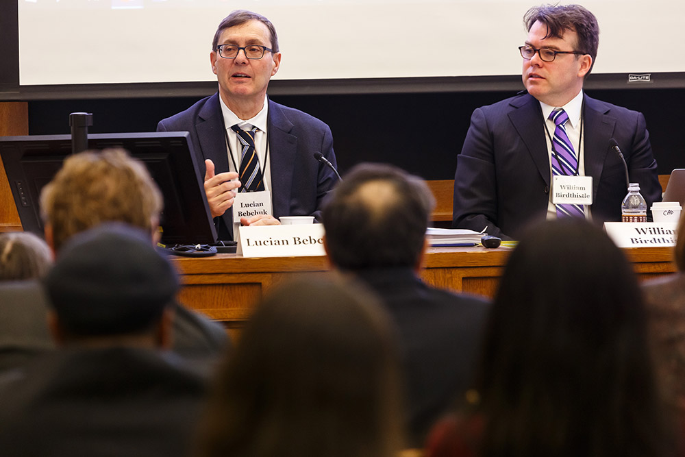 Harvard Law Prof. Lucian Bebchuk presenting, while Chicago-Kent College of Law Prof. William Birdthistle listens