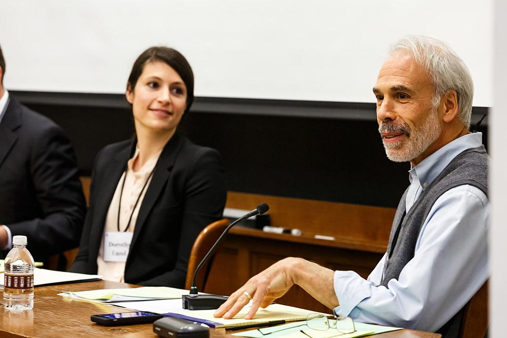 NYU Law Prof. Edward Rock presenting, while USC Law Prof. Dorothy Lund listens