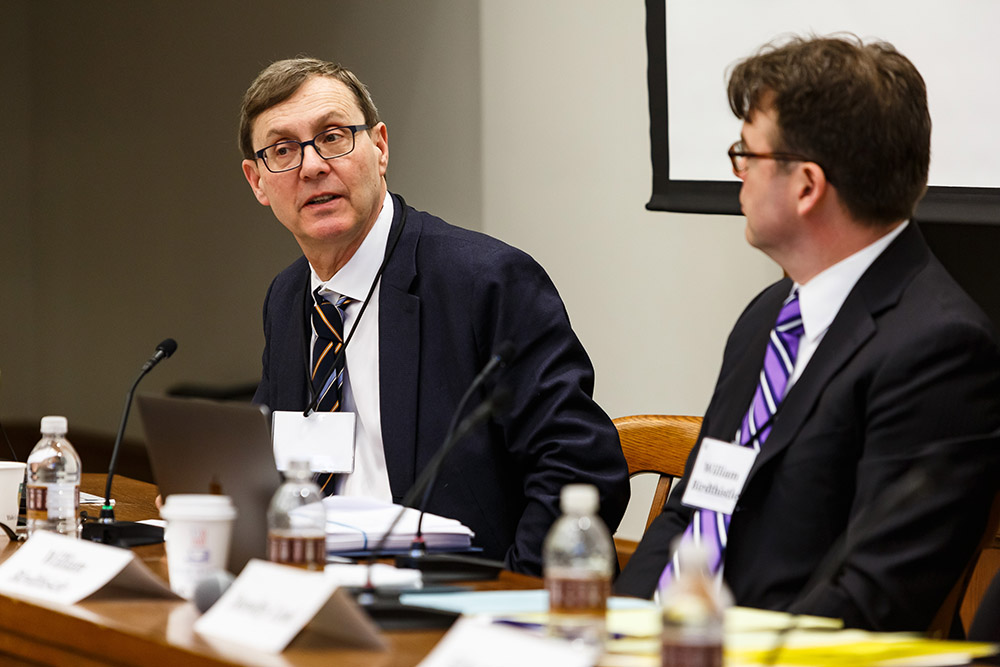 Harvard Law Prof. Lucian Bebchuk commenting, while Chicago-Kent College of Law Prof. William Birdthistle listens