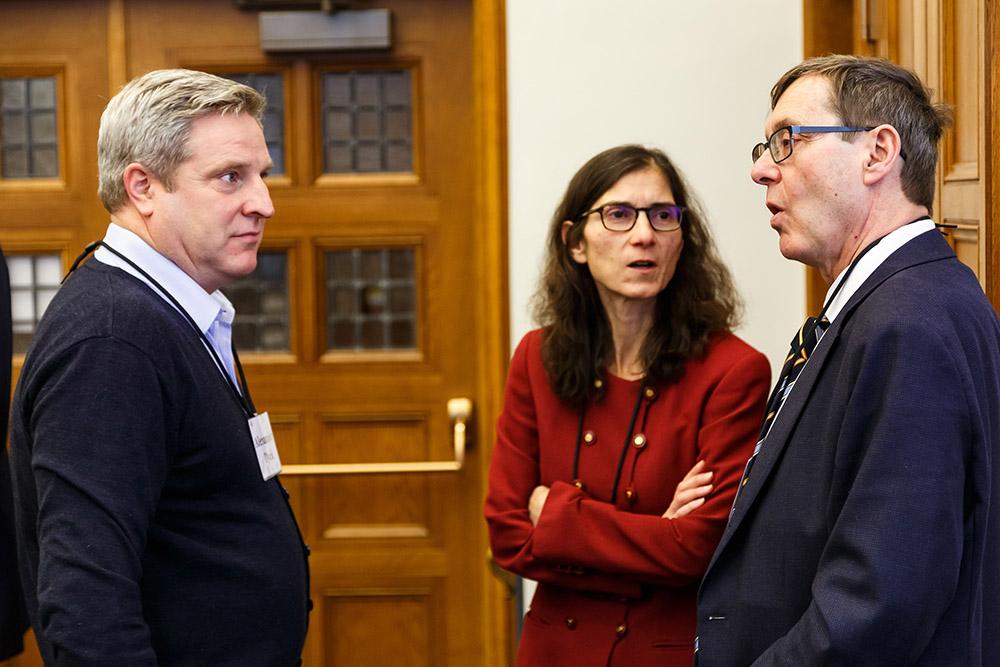 U. of Toronto Rotman Prof. Alexander Dyck, Rosa Testani '88, and Harvard Law Prof. Lucian Bebchuk conversing