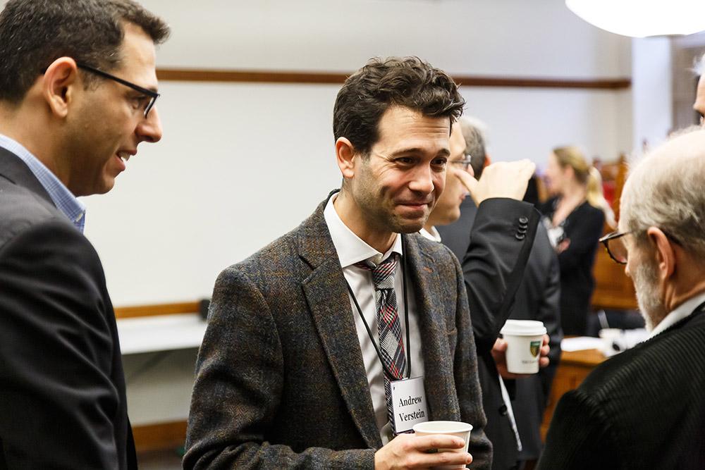 Duke Law Prof. Ofer Eldar JSD '14, Wake Forest Law Prof. Andrew Verstein '09, and YLS Prof. Henry Hansmann '74 conversing