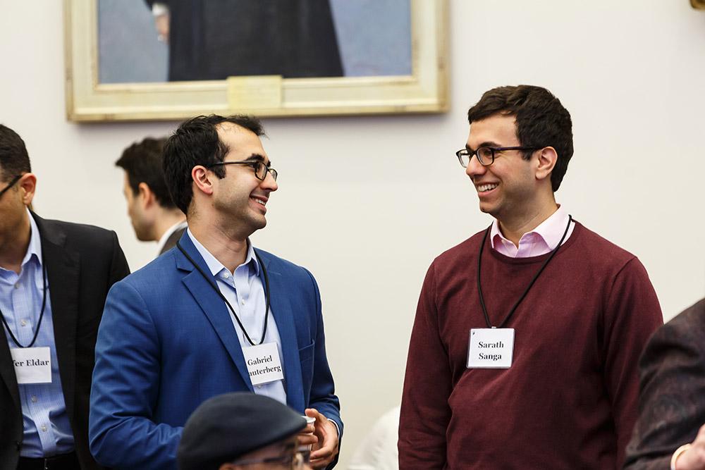 Michigan Law Prof. Gabriel Rauterberg '09 and Northwestern Law Prof. Sarath Sanga '14 conversing