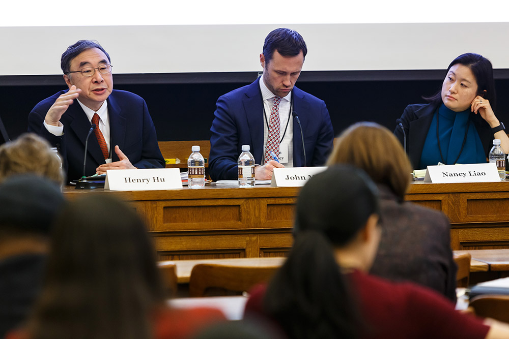 Texas Law Prof. Henry T.C. Hu '79 presenting, while YLS Prof. John Morley '06 and Center Exec. Dir. Nancy Liao '05 listen