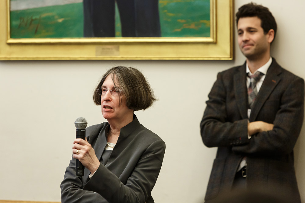 YLS Prof. and Center Dir. Roberta Romano '80 asking a question, while Wake Forest Law Prof. Andrew Verstein '09 listens