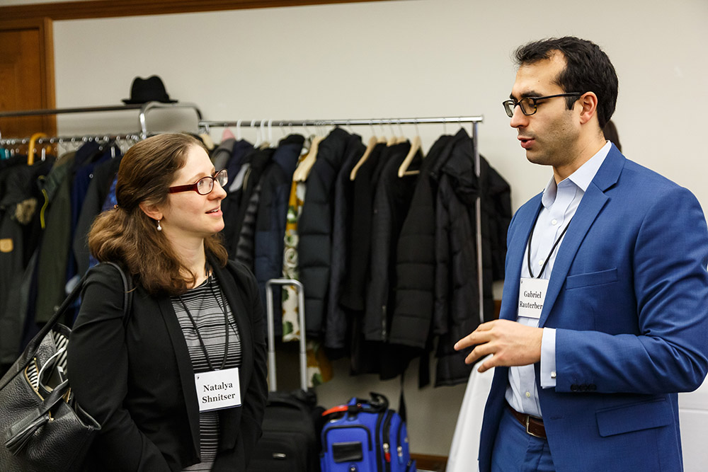Boston College Law Prof. Natalya Shnitser '09 and Michigan Law Prof. Gabriel Rauterberg '09 conversing