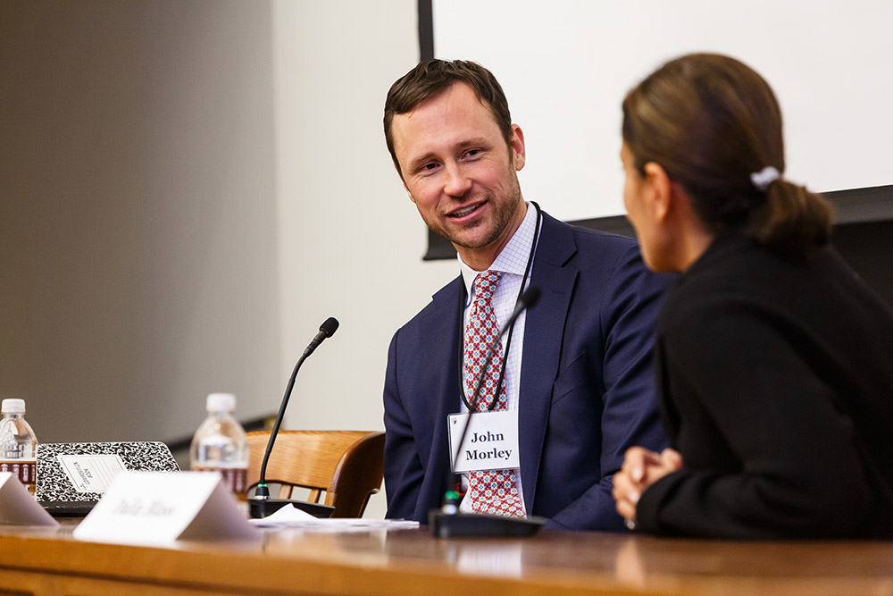 YLS Prof. John Morley '06 asking a question of SEC Div. of Investment Mgmt. Dir. Dalia Blass