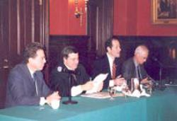 (From left) Anthony Kronman '75, Jonathan Macey '82, Eliot Spitzer, and Alan Schwartz '64