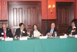 (From left) Erik R. Sirri, Henry Hu '79, Roberta Romano '80, Charles M. Nathan '65, and Dean Harold Koh