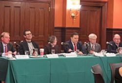 (From left) Paul S. Atkins, Andrew Metrick, Roberta Romano '80, Gabriel D. Rosenberg '09, Lawrence White, and Michael M. Wiseman
