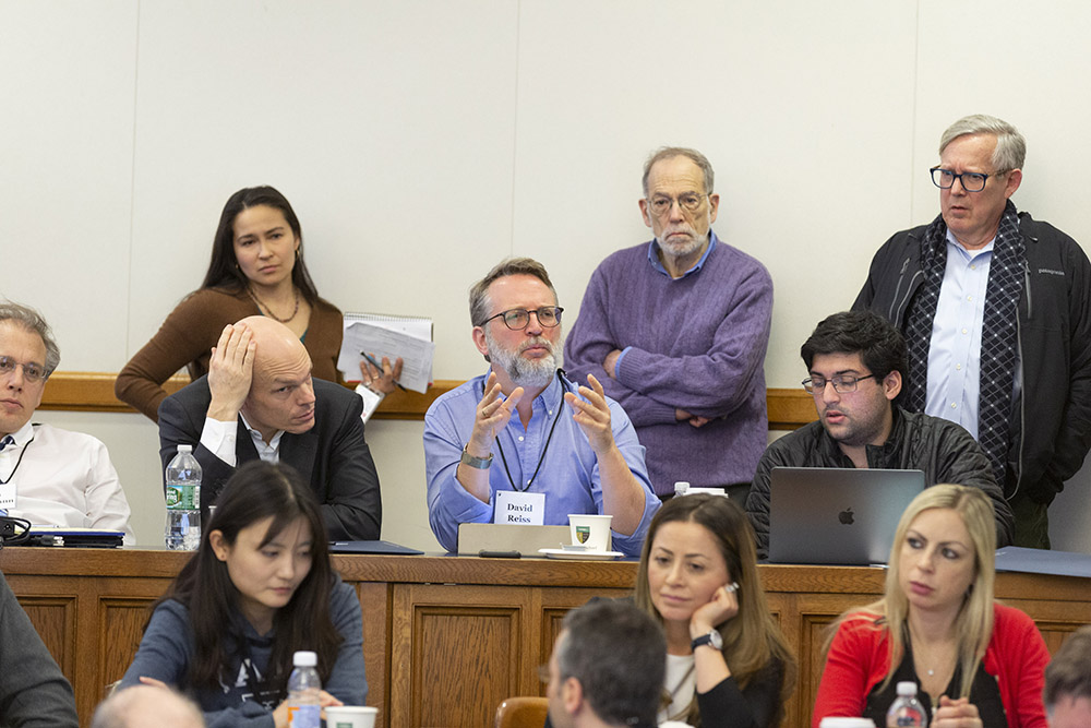 Brooklyn Law Prof. David Reiss asking a question, with Harvard Law Prof. Holger Spamann, YLS Prof. Al Klevorick, Yale SOM Prof. Gary B. Gorton, and Case Western Reserve Law Prof. Anat Alon-Beck, among others, listening