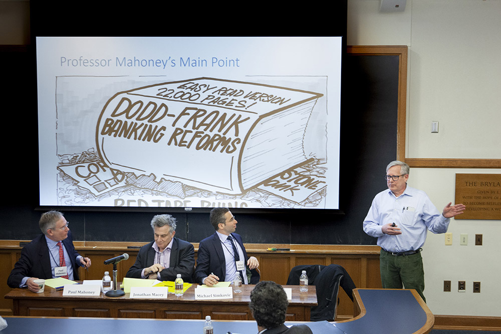 "Yale SOM Prof. Gary B. Gorton discussing ""The Regulatory Effect"" by UVA Law Prof. Paul G. Mahoney '84, while YLS Prof. Jonathan R. Macey '82 and USC Law Prof. Michael Simkovic listen"