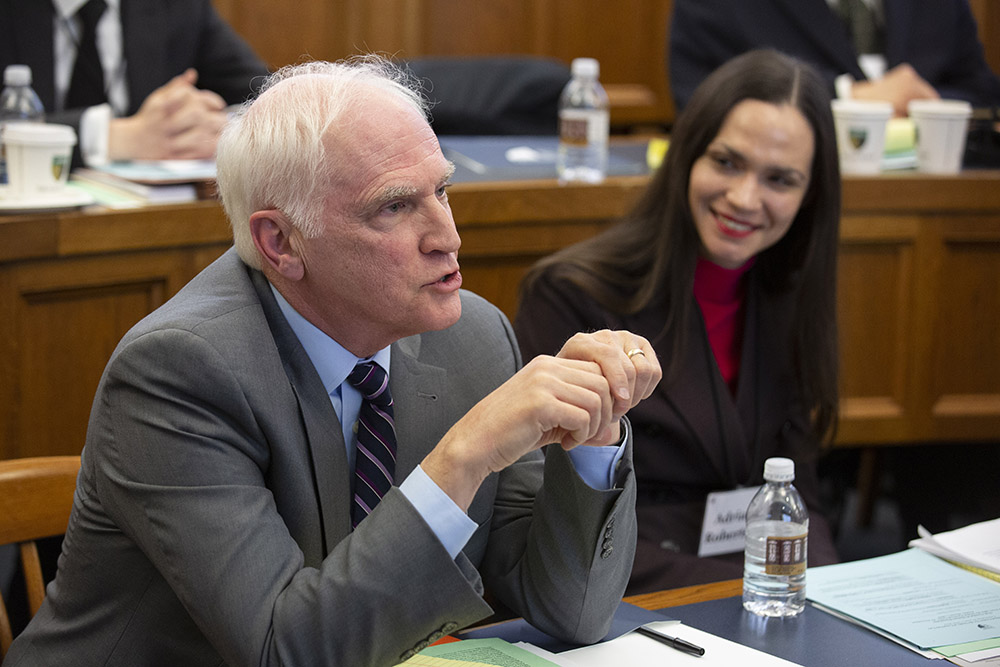 Harvard Law Visiting Prof. and former Fed. Res. Bd. Gov. Daniel K. Tarullo asking a question, while U. of Toronto Faculty of Law Prof. Adriana Robertson '15 listens