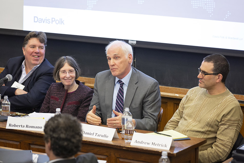 Harvard Law Visiting Prof. and former Fed. Res. Bd. Gov. Daniel K. Tarullo speaking, while Systemic Risk Council Chair and former Deputy Gov. of the Bank of England Sir Paul Tucker, YLS Prof. and Center Dir. Roberta Romano '80, and Yale SOM Prof. Andrew Metrick listen