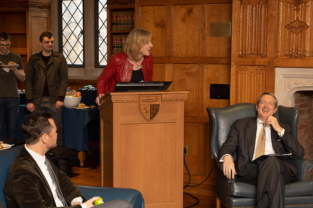 YLS Dean Heather Gerken introducing Vice Chair Randal K. Quarles '84, with YLS Prof. John Morley '06 (left) looking on